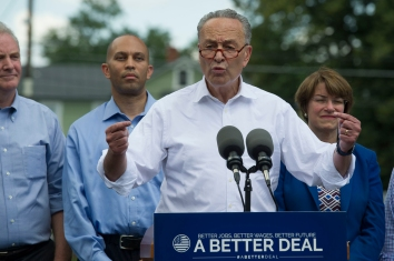Senate Minority Leader Chuck Schumer of N.Y., accompanied by Congressional Democrats, speaks in Berryville, Va., Monday, July 24, 2017, to unveil their new agenda. From left are, Sen. Chris Van Hollen, D-Md., Rep. Hakeem Jeffries, D-N.Y., Schumer, and Sen. Amy Klobuchar, D-Minn. (AP Photo/Cliff Owen)